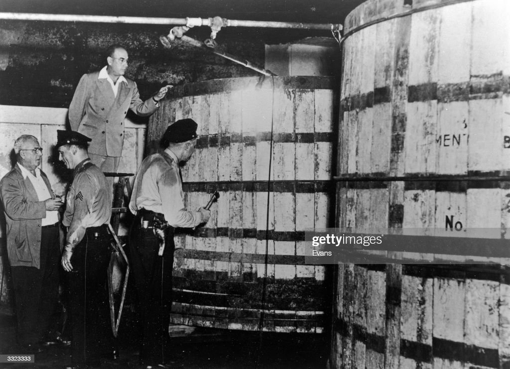 American Revenue agents inspect a meat packing warehouse in Philadelphia, which fronted a large illicit alcohol distillery.