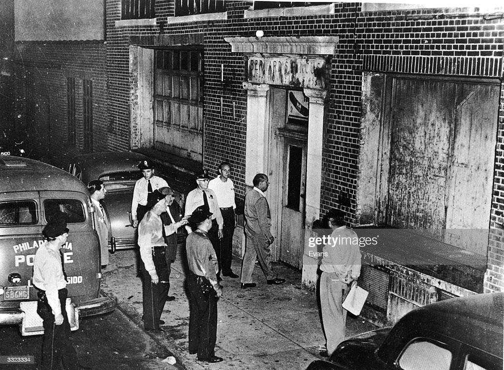 American Revenue agents inspect a meat packing warehouse in Philadelphia, which fronts a large illicit alcohol distillery.