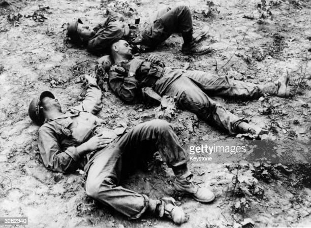 American troops resting on a Korean battlefield.