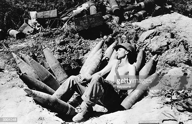 An American soldier sleeps on his ammunition in the Mason area during the Korean war.