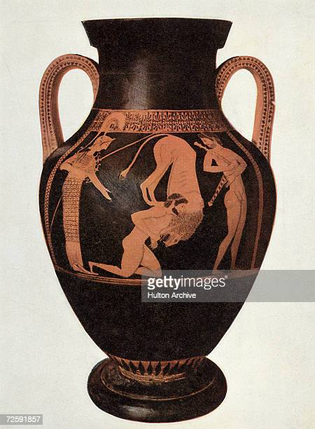 An ancient Greek redfigure amphora from around 500 BC depicting Heracles defeating the Nemean Lion the first of his twelve labours The goddess Athena...