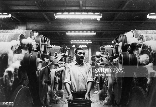 An immigrant employee from Pakistan at work in a spinning mill in Bradford West Yorkshire the worstedmanufacturing and wooltrade centre of England