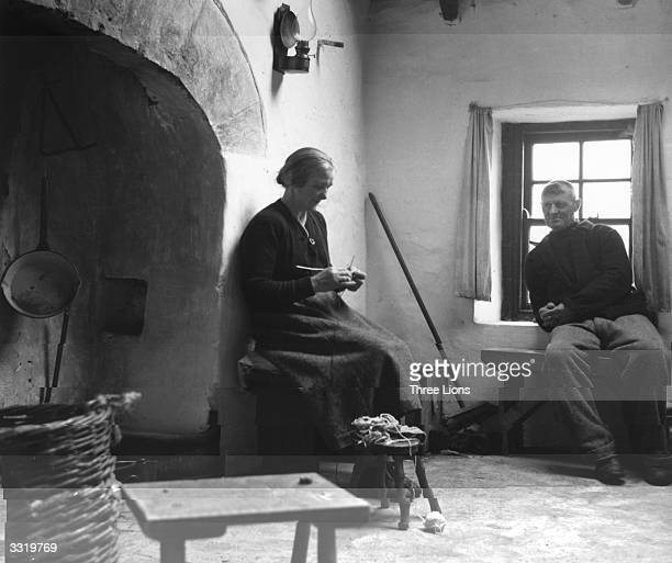 An Irish couple at home in their cottage on the Aran Islands in County Galway