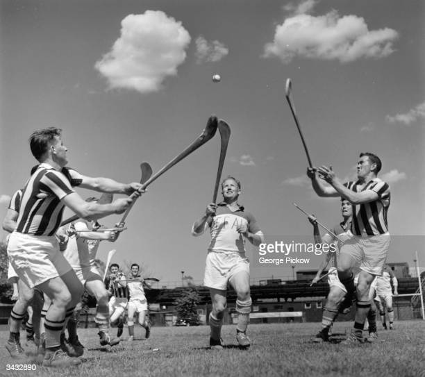 An Offaly man comes through the centre only to have the ball knocked off his ash by an opponent during a game of hurling