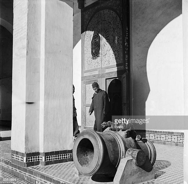 An old Moroccan cannon in the courtyard of the Dar Batha Palace Fez which is now used as a art museum