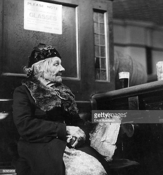 An old woman sitting in the Green Man a pub in Bethnal Green London