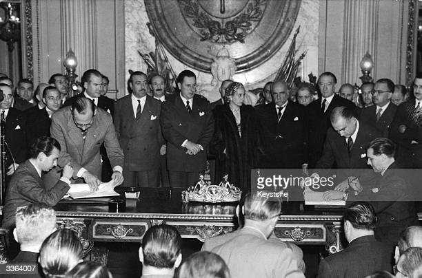 Argentine President Juan Peron with his wife Eva centre at the signing of the Anglo Argentine meat agreement in Buenos Aires