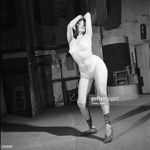 Bikiniclad burlesque dancer Brenda Conde shows some moves backstage at the Tivoli Theatre Mexico City