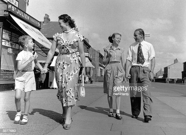 Blackpool Football Club player Stanley Matthews with his wife and children in Blackpool
