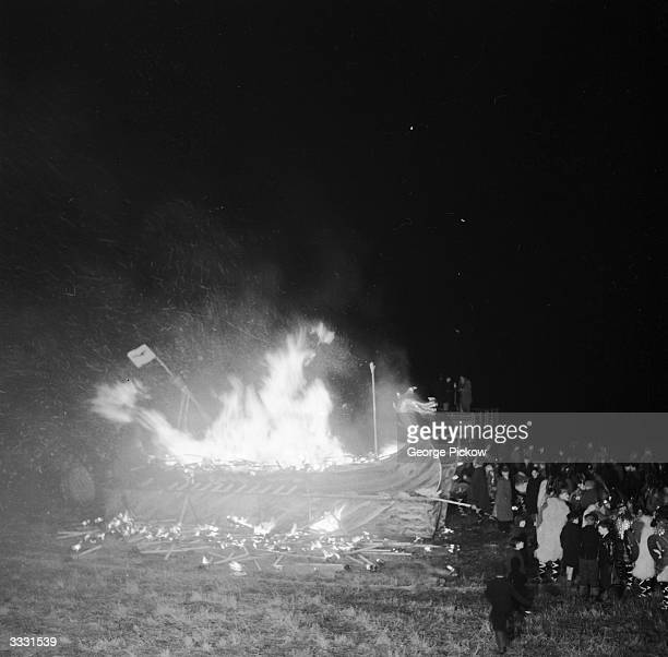 Celebrators at the Lerwick 'UpHellyAa' watch a replica of a Viking galley burning The galley forms the centrepiece of annual celebrations...