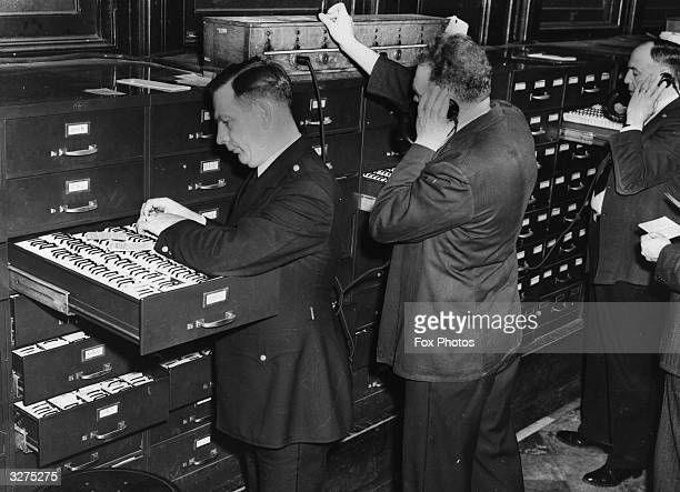 Checking police records and answering phone calls to the Detective Bureau of Information in New York