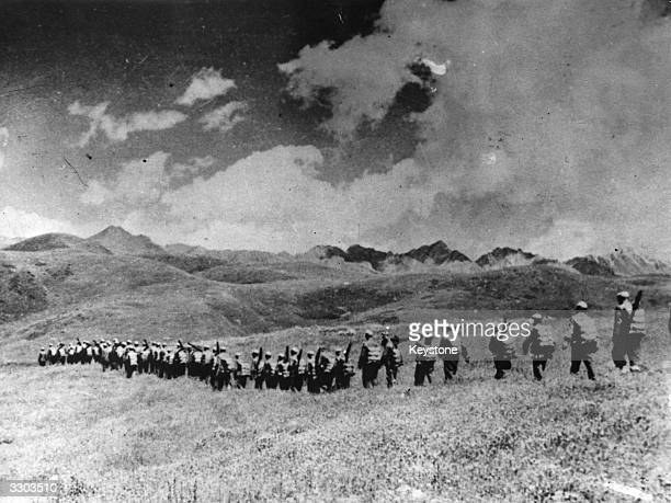 Chinese troops march over the highlands towards the Tibetian frontier after their invasion of Tibet.