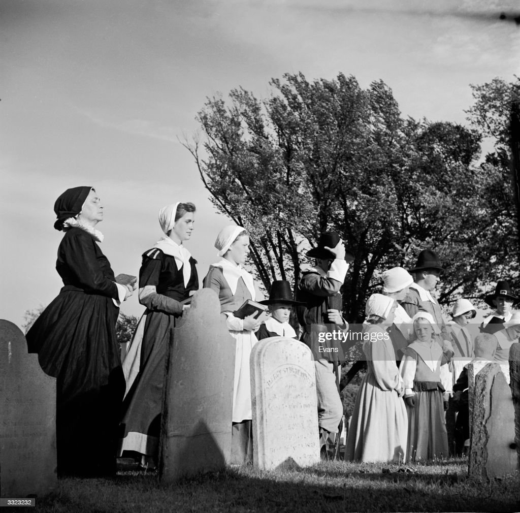Citizens of Plymouth, Massachusetts, New England, re-enacting an event from 1620 when the Pilgrim Fathers settled in the New World. The Pilgrims offer up their first Thanksgiving in the churchyard where those who founded the colony are buried.