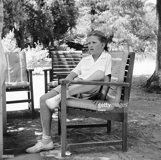 Crown Prince Constantine of Greece sitting in the garden at the royal summer residence in southern Greece