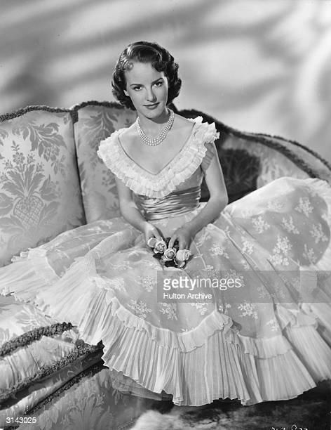 English singer Petula Clark Her party dress has a heart shaped neckline edged with three layers of frills there is a broad sash at the waist and the...
