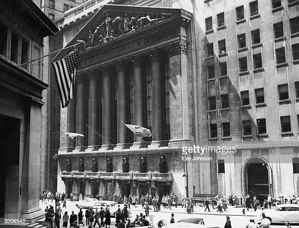EXCLUSIVE Exterior view of the New York Stock Exchange building with pedestrians moving past New York City
