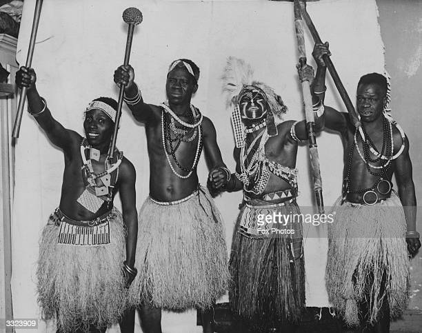 Four west African dancers bringing real African dancing to London. The centre left dancer waving a knobkerrie is a chief's son whilst Jugobia with a...