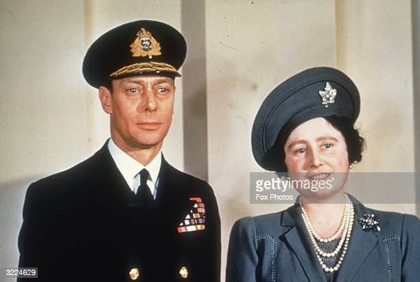 King George VI and his wife Queen Elizabeth dressed for an official engagement.