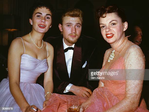 L to r film stars Jean Simmons Laurence Harvey and Judy Garland at a Beverly Hills party A Wonderful Time Slim Aarons