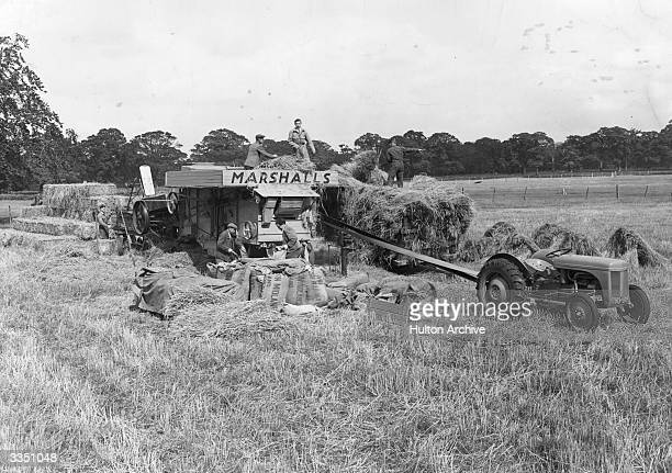 Making use of the threshing machine in late Summer