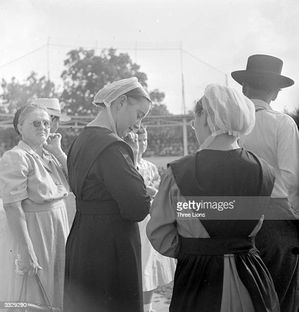 Mennonite women in Pennsylvania cover their heads with white mull caps