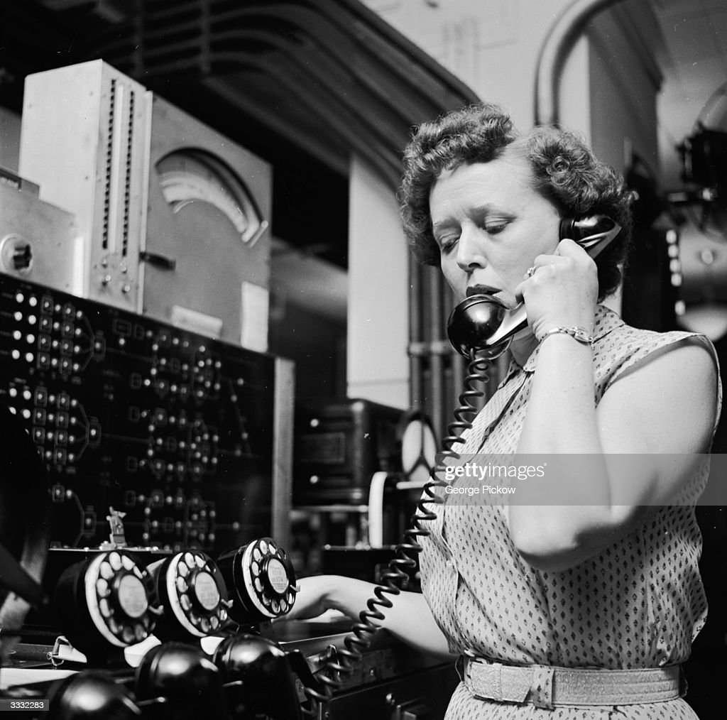 Mrs Margarita Eckman at the New York Stock Exchange master control panel, which supervises all ticker tape printing machines.