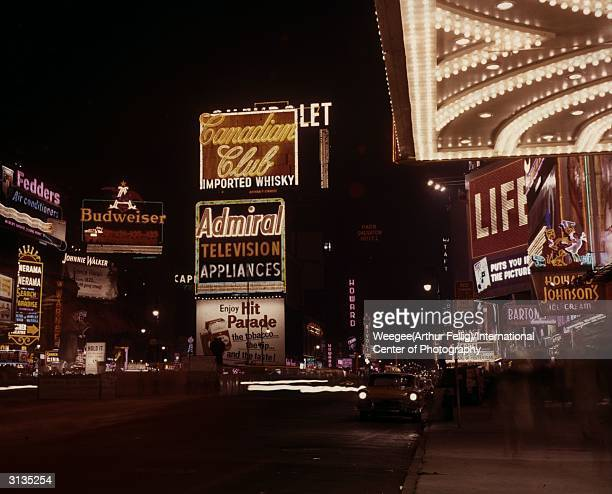 Neon signs in Times Square Manhattan New York City Photo by Weegee/International Center of Photography/Getty Images