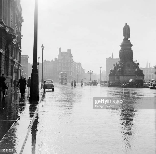 O'Connell Street in Dublin on a rainy day On the right is a large statue of Daniel O'Connell leader of the fight to win political rights for Irish...