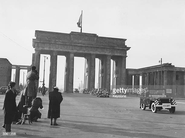 Official vehicles passing through the Brandenburg Gate East Berlin