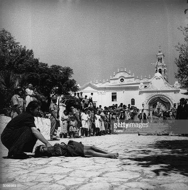 Pilgrims believe their prayers will be answered if they roll along the road up to the church on Tinos supposed island of miracles A mother is seen...
