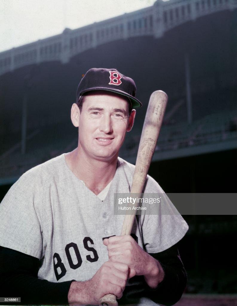 Portrait of American baseball player Ted Williams (1918 - 2002), aka 'The Splendid Splinter,' wearing his Boston Red Sox uniform and holding a bat.