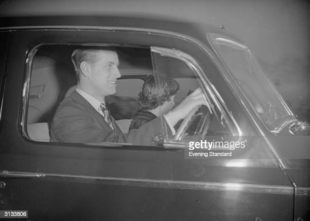 Prince Philip driving his car with Princess Elizabeth later Queen Elizabeth II of Great Britain in the passenger seat