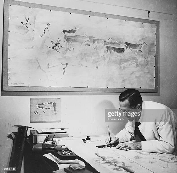 Professor van Riet Lowe retracing his preliminary copies of Bushman paintings in his office in South Africa The large work on the wall is a...
