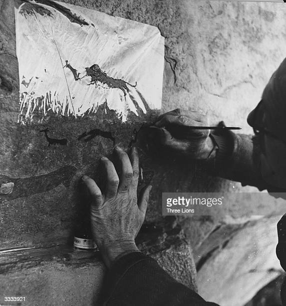 Professor van Riet Lowe tracing a Bushman cave painting onto cellophane