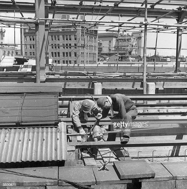 Railroad workers at the Shinagawa Station in Tokyo