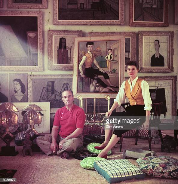 Romanian director Jean Negulesco and his model wife Dusty sitting before a portrait of Dusty by Noyer Negulesco directed the film 'Three Coins in the...