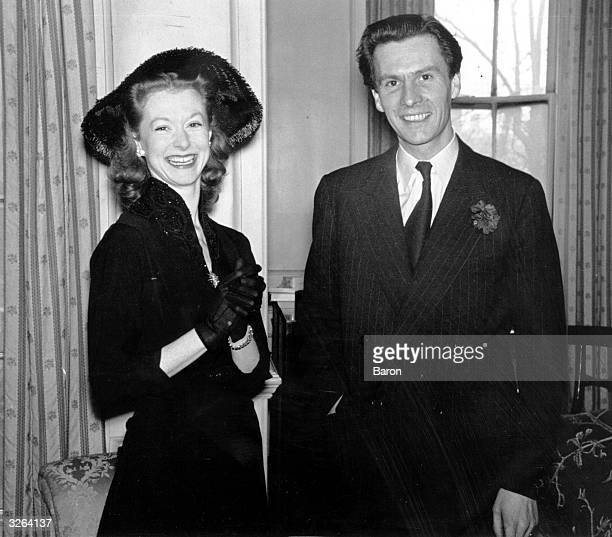 Scottish broadcaster and writer Ludovic Henry Coverly Kennedy with his wife ballerina Moira Shearer on the occasion of their daughter's christening