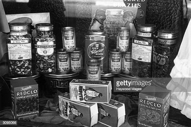 Some of the goods on sale in a confectioners shop include toffees lozenges fruit gums and mints Original Publication Picture Post 1135 Isle Of Man...