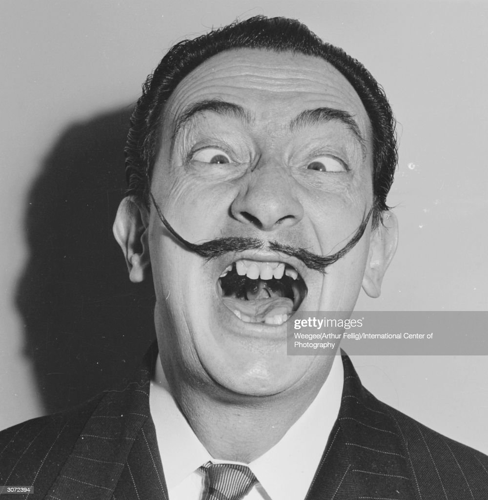 Spanish surrealist artist Salvador Dali (1904 - 1989) shows off his famous moustache. (Photo by Weegee(Arthur Fellig)/International Center of Photography/Getty Images)