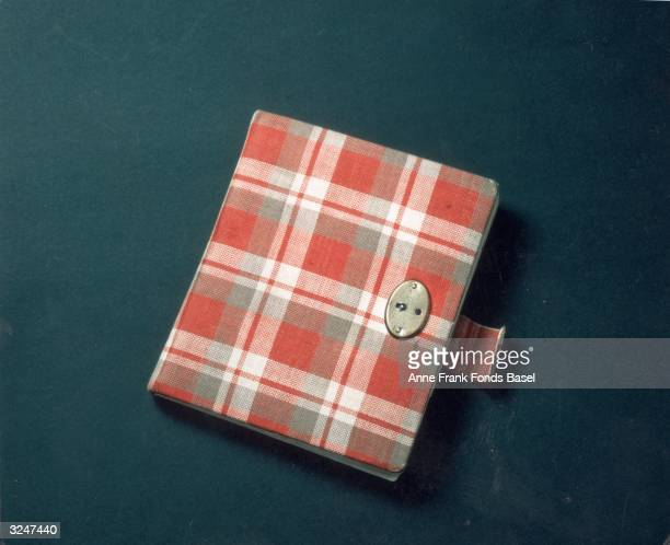 Still life of Anne Frank's red plaid diary her first journal in which she wrote from 1942 to 1944