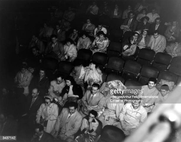 The audience watching a film in the Palace Theatre. Taken with infrared negative.