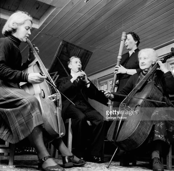 The Dolmetsch family foremost interpreters of Elizabethan music playing together From left to right Natalie Carl Marie and Mabel Dolmetsch on the...