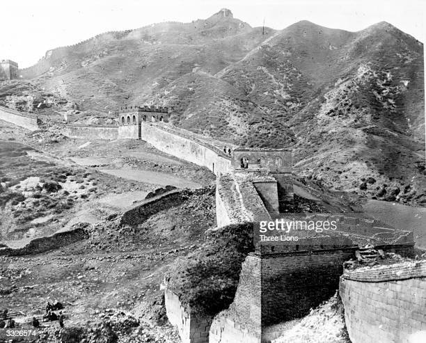 The Great Wall of China at Nankow Pass 1900 ft above sea level The wall runs for 1550 miles is 50 ft high and 1520 feet wide with a watch tower every...