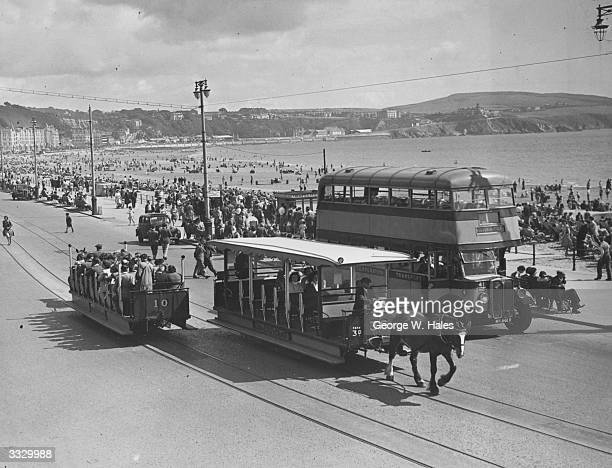 The horse drawn trams ferrying tourists along the front in Douglas Isle of Man
