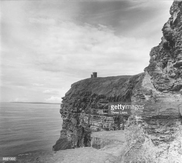 The Moher Cliffs which rise 700 feet above the Atlantic near Limerick Ireland O'Briens tower stands on the furthermost cliff