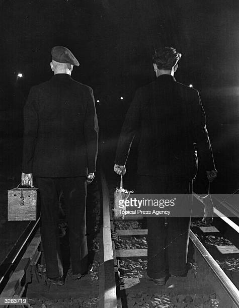The rat catchers set off down the tunnels of the London Undgerground after the last train to catch rats