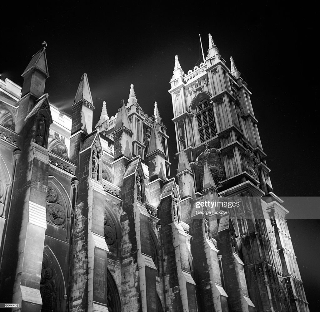 The southside of Westminster Abbey, London, artificially illuminated at night.