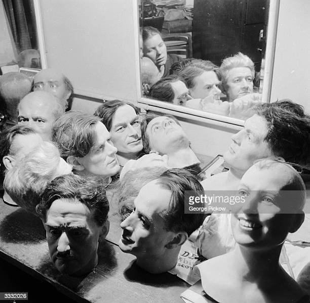 The waxwork heads of various celebrities sit on a table waiting to be repaired or melted down at Madame Tussaud's waxworks museum London