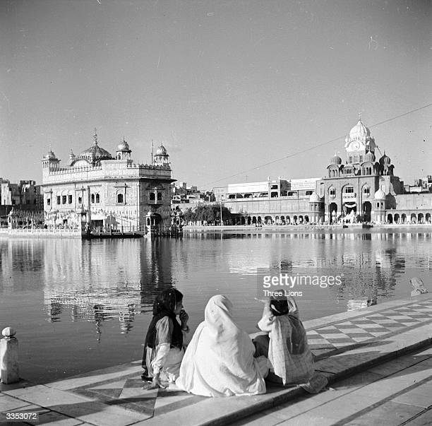 Three women waiting to be admitted to the sacred grounds of the Golden Temple at Amritsar.