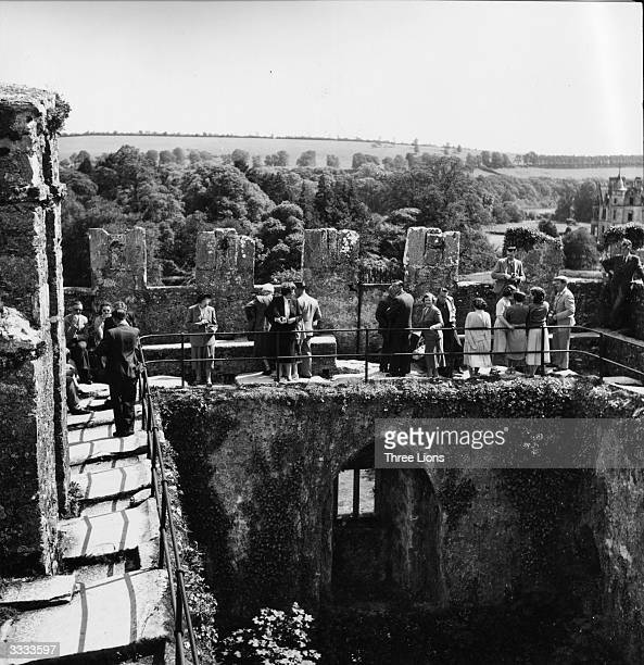 Tourists on the battlements of Blarney Castle in County Cork The Blarney Stone is between the third and fourth merlons